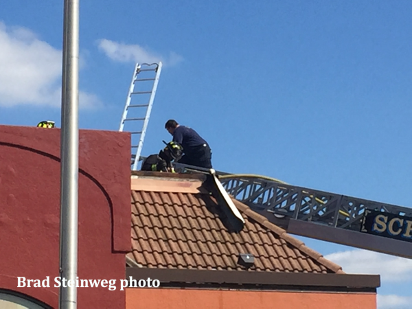 Schererville firefighters on roof