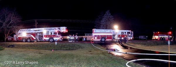 fire trucks at night fire scene