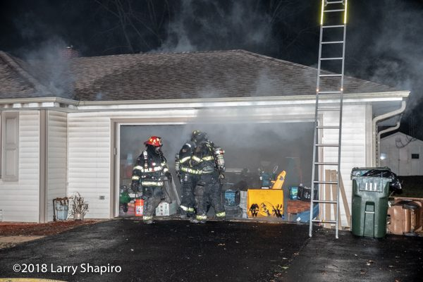 Firefighters open garage door during house fire