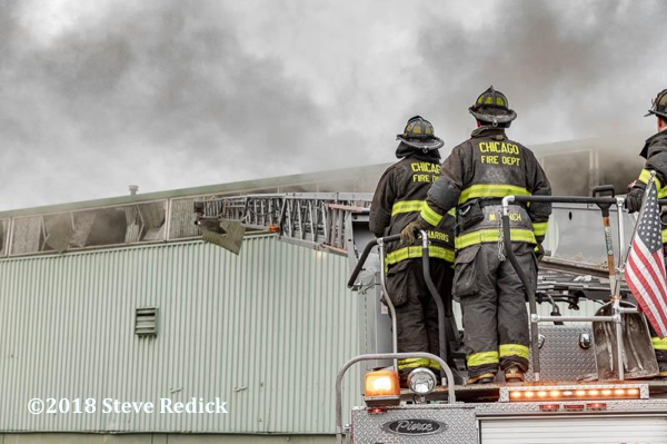 Chicago Firefighters on aerial ladder turntable