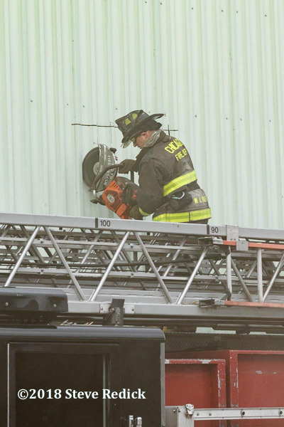 Firefighter vents metal clad building