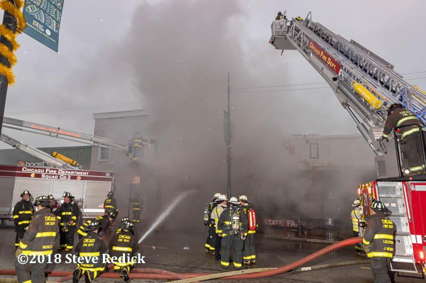 Chicago Firefighters battle a store front fire