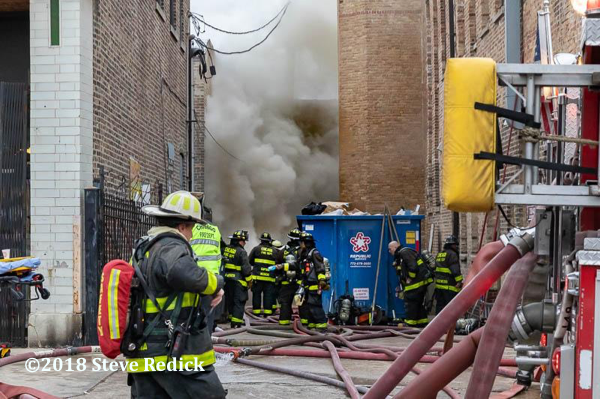 heavy smoke in alley from commercial building fire