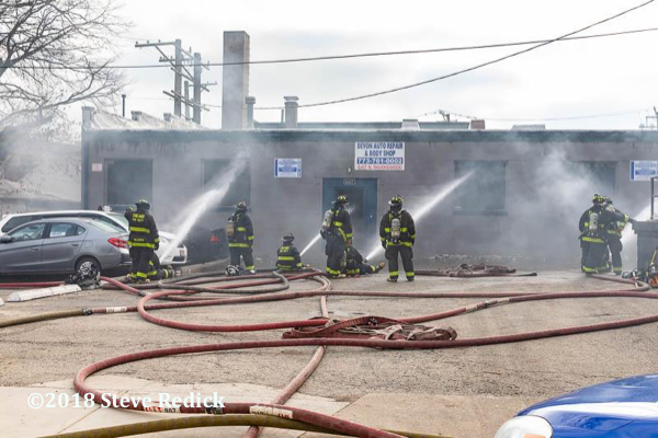 Firefighters battle commercial building fire