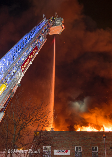 E-ONE tower ladder battles warehouse fire at night