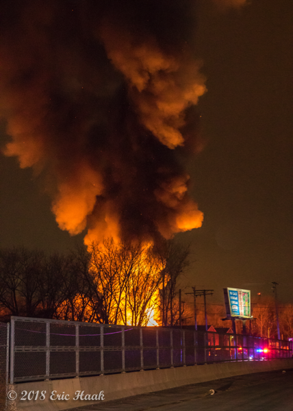 massive flames from warehouse fire at night