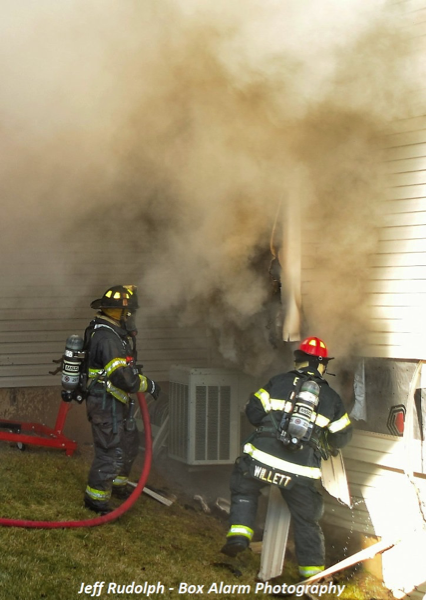 Firefighters fight house fire
