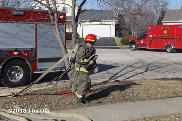 Firefighter pulls hose