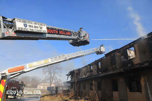 tower ladders at work battling a fire