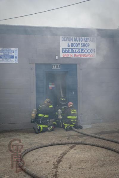 Firefighters battle a fire