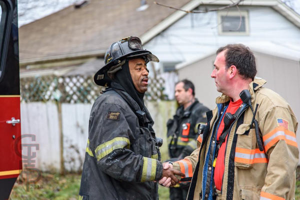 African American and white Firefighters together