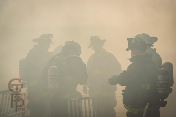 Firefighters immersed in smoke