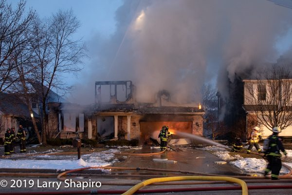 house on fire destroyed by an explosion