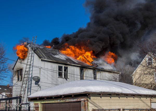 massive flames and smoke from roof of house on fire