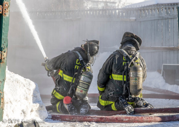 Firefighters battle fire in bitter cold conditions