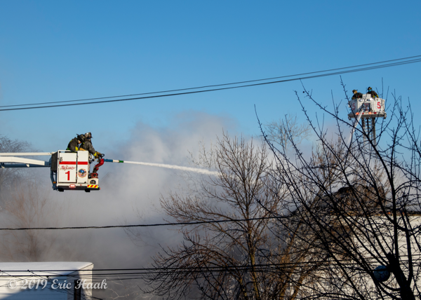 Chicago FD Snorkel and tower ladder at work
