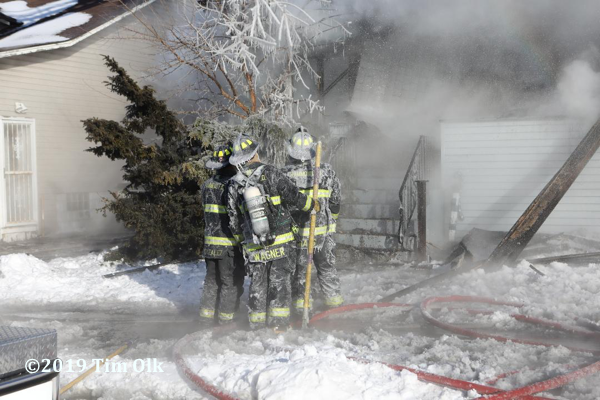 Firefighters coated with ice at fire scene