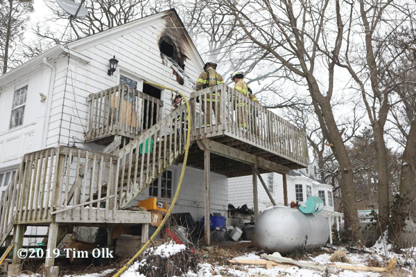 house badly damaged by fire