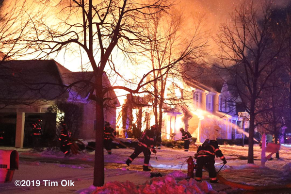 Firefighters battle houses on fire at night