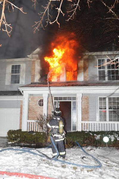 Firefighter battles house fire at night