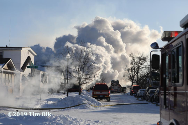 Firefighters battle house fire in frigid weather