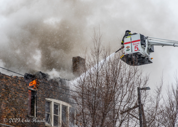 Chicago FD Squad 5A Snorkel at work battling fire in a cockloft