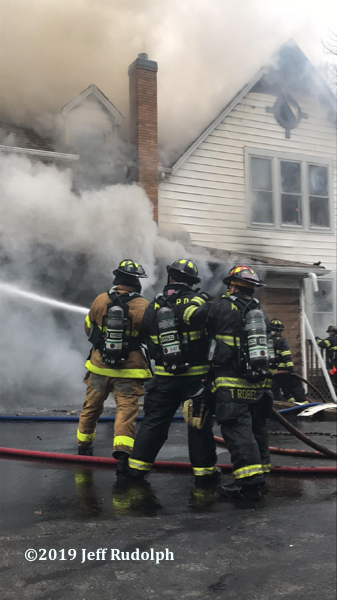 Firefighters battle fire in a large house