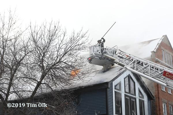 Firefighters battle attic fire