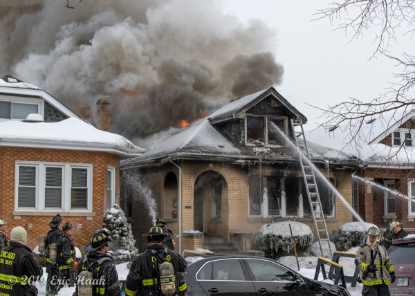 fire engulfs a Chicago bungalow in frigid weather