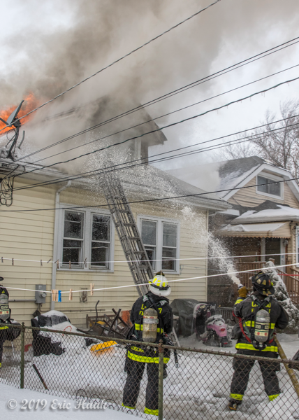 Firefighters battle fire as it engulfs a Chicago bungalow in frigid weather