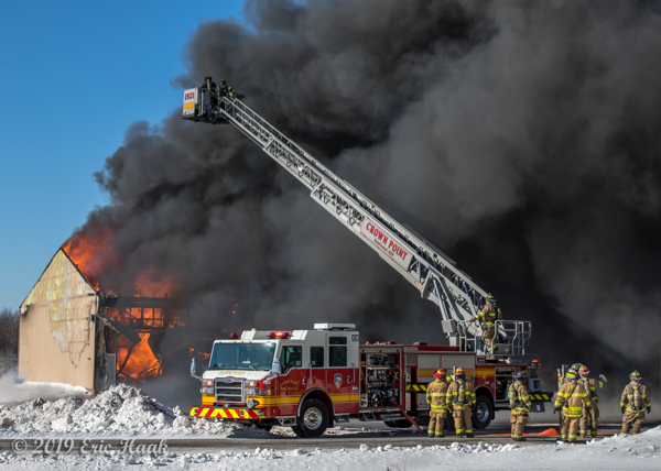 Crown Point FD quint battles a fire with heavy black smoke