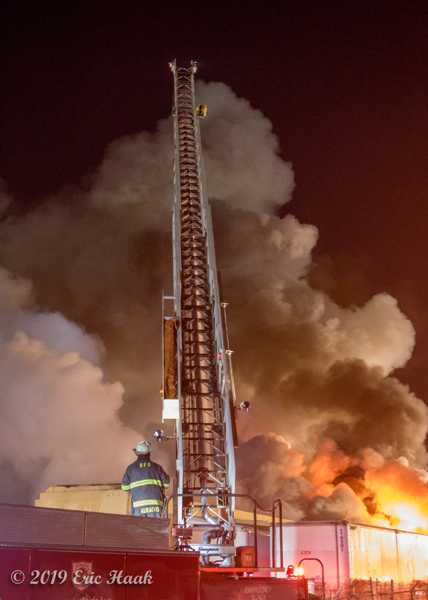 elevated master stream battles nighttime fire