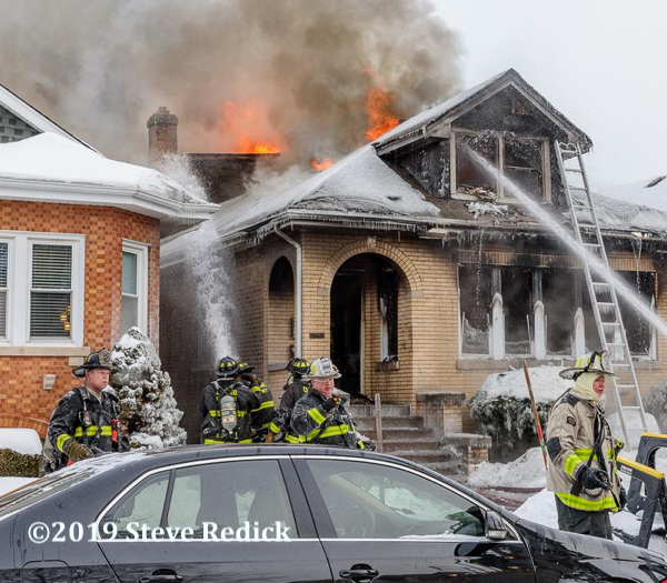 heavy smoke and flames from Chicago bungalow fire