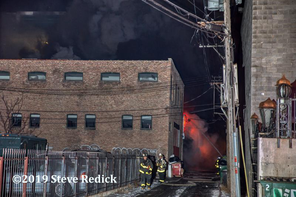 industrial building fire with heavy smoke