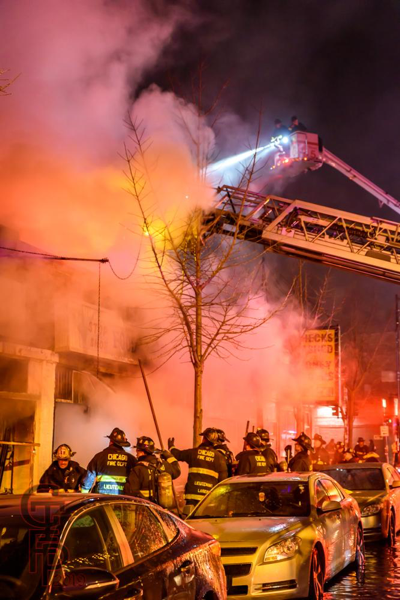 Chicago Firefighters battle storefront fire at night