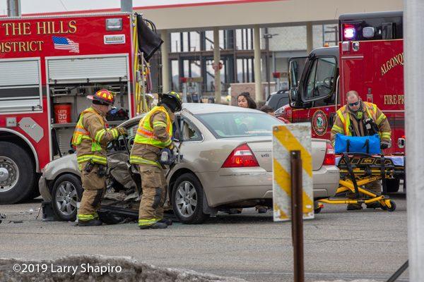 Firefighters using Hurst eDraulic rescue tools at crash scene
