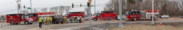 panoramic view of crash scene with fire trucks and ambulances