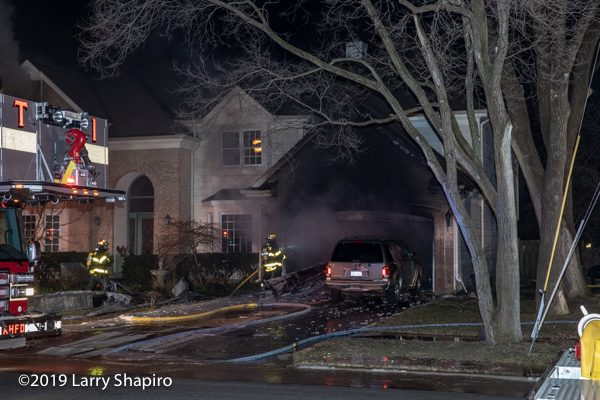house fire at night from garage