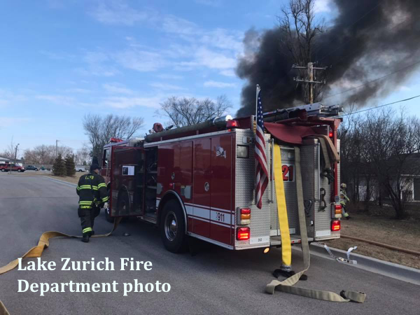 Lake Zurich FD engine with lines off at fire