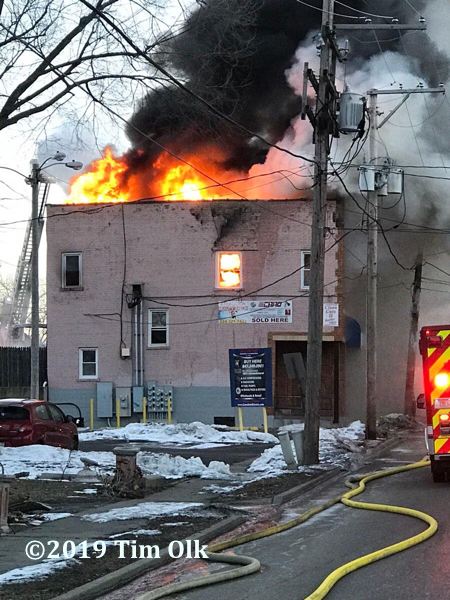 heavy fire through roof of building