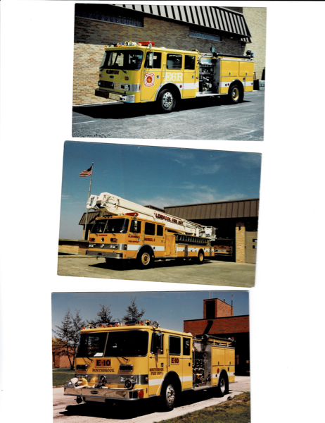 vintage yellow Pierce Arrow fire trucks