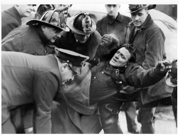 vintagetribune Firemen carry John Hendricks of Engine Company No. 11 out of Riccardo's restaurant after he was overcome by gas and smoke on Nov. 29, 1940. A second fireman was also overcome in the blaze at the Rush Street cafe. #ChicagoFire #CFD #Riccardos #Ricks