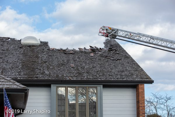 aftermath of cedar shake roof after a fire