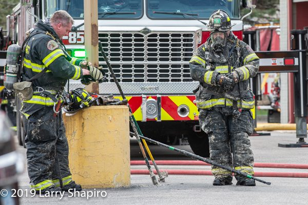 Schaumburg FD firefighters covered with insulation after overhaul