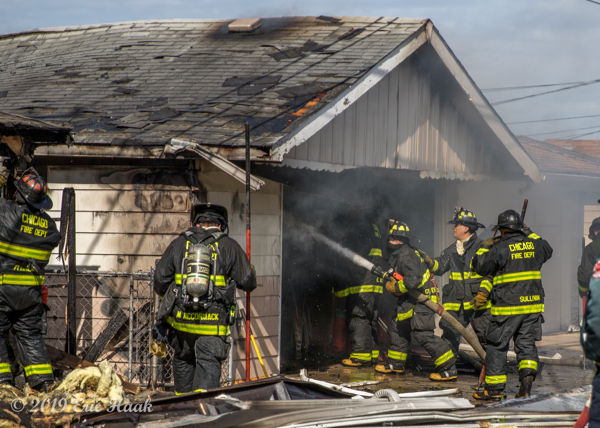 Firefighters fight alley garage fire