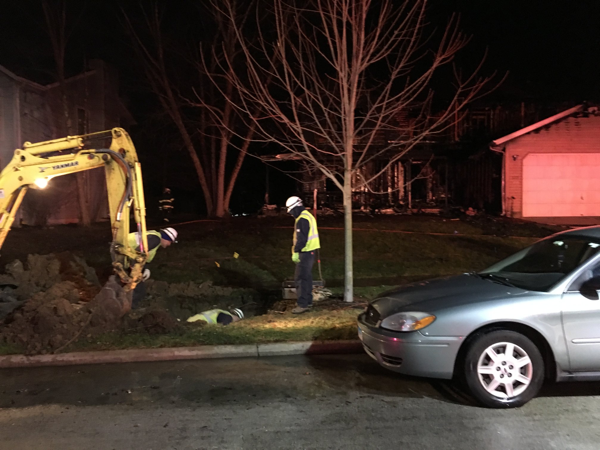gas utility workers at fire scene