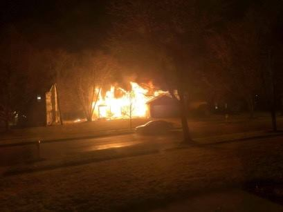 house fully engulfed by fire at night