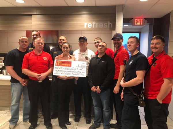 West Frankfort FD members received a donation after working in a McDonald's restaurant in town
