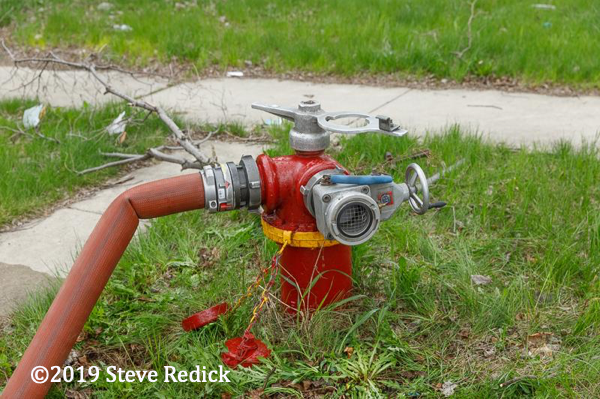 Chicago fire hydrant with hose attached