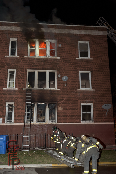 fire in 3rd floor apartment at night